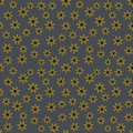 Vector seamless pattern of yellow flowers on a denim background