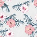 Vector seamless tropical pattern, vivid tropic foliage, with palm leaves, tropical pink hibiscus flower in bloom. Modern bright su