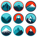 Vector set with abstract logos mountains and icons and summits in blue color Stock Photos