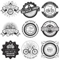 Vector set of bicycle repair shop labels and design elements in vintage black and white style. Bike logo Royalty Free Stock Photo