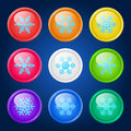 Vector set of buttons glossy with snowflakes on dark background Royalty Free Stock Photos
