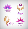 Vector set of spa logos. Lotus, massage, hands with butterfly salon icons, signs. Royalty Free Stock Photo