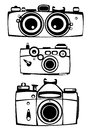 Vector set of three vintage film photo cameras isolated on white Stock Photography