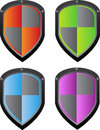 Vector shield in four color variants red green blue and purple eps format is available Stock Photos