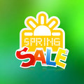 Vector spring sale theme with paper sun on green background Stock Photos