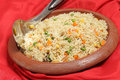 Veg pulao rice in clay bowl vegetable pilau or pulau an ethnic indian terracotta with a serving spoon Royalty Free Stock Photo