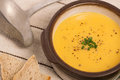 Vegan carrot and potato soup with homemade bread and ladle Stock Photography