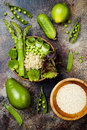 Vegan, detox green Buddha bowl recipe with quinoa, cucumber, broccoli, asparagus and sweet peas. Royalty Free Stock Photo