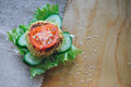 Vegan diet Burger appetizer with chickpeas lentil cutlet, cucumber, fresh lettuce, and tomato. Sprinkle with sesame Royalty Free Stock Photo