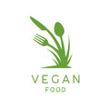 Vegan food logo of plant, fork, knife and spoon icon.