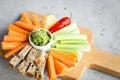 Vegan healthy snacks: guacamole, carrots, celery Royalty Free Stock Photo