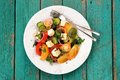 Vegan homemade greek salad with raw vegetables and feta cheese i Royalty Free Stock Photo