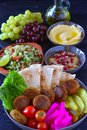 Vegan mediterranean lunch platter with olive oil jug Royalty Free Stock Photo