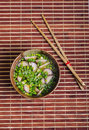 Vegan miso soup with raw spring onion and radish Stock Photo