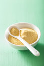Vegan nutritional yeast flakes in bowl Royalty Free Stock Photo