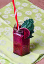 Vegan raw smoothie with beetroot kale apples and grapes Royalty Free Stock Photos