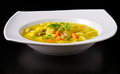 Vegan soup dish plate on black background with blurred reflection Royalty Free Stock Photos