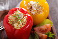 Vegan stuffed peppers with rice mushrooms and vegetables Stock Photos