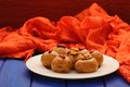 Vegan sweets with wallnuts and goji berries on orange ethnic clo Royalty Free Stock Photo