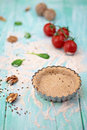 Vegan tart dough on rustic blue board with nuts and cherry tomatoes Royalty Free Stock Photography