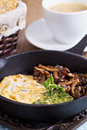 Vegan tofu omelet with mushrooms and pesto Royalty Free Stock Photography