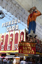 Vegas vic and fremont street experience historic neon casino signs are shown in las pioneer club the statue are shown Stock Images