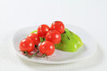 Vegetable accompaniment tomatoes and bell peppers on plate Stock Photography