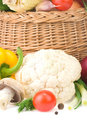 Vegetable and basket on white Stock Photography