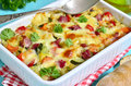 Vegetable casserole with pork shank and cheese Royalty Free Stock Image