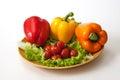 Vegetable cherry tomato pepper salad on white background Stock Photo