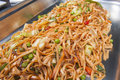 Vegetable chow mein meal at a buffet closeup of chinese on display hotel Royalty Free Stock Images