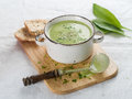 Vegetable cream soup delicious with broccoli and parsley selective focus Royalty Free Stock Image