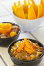 Vegetable curry with lentils topped with a carrot knot and bowl of tuscan style lamb shanks Stock Photos