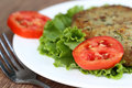 Vegetable cutlet and salad on plate Stock Photo