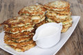 Vegetable fritters of zucchini with parsley and dill closeup  . Royalty Free Stock Photo