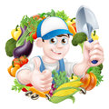 Vegetable gardener in a cap holding a garden trowel tool and giving a thumbs up surrounded by fresh produce Royalty Free Stock Photo