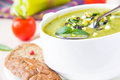 Vegetable green healthy cream soup with avocado celery zucchin zucchini and herbs in a white cup as an appetizer Royalty Free Stock Photos