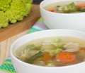 Vegetable healthy soup with vegetables romanesco cabbage green beans and carrots Royalty Free Stock Images