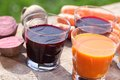 Vegetable juice carrot and beetroot on a garden table Stock Image