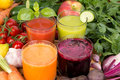 Vegetable juice tomato carrot cucumber and beetroot Royalty Free Stock Image