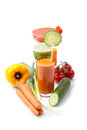 Vegetable juices with carrot cucumber tomato carrots sweet pepper white background Stock Images