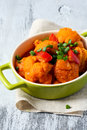 Vegetable korma with cauliflower red pepper and spring onions Stock Photo