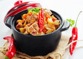 Vegetable and meat stew with chili pepers selective focus Royalty Free Stock Photo