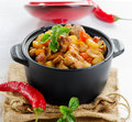 Vegetable and meat stew with chili pepers selective focus Stock Photo