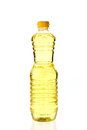 Vegetable oil for cooking in a bottle isolated on white Royalty Free Stock Photo