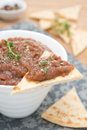Vegetable pate of eggplant and tomatoes on a piece of pita bread selective focus vertical Royalty Free Stock Images