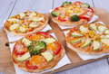 Vegetable pizza small on wooden board Royalty Free Stock Photo