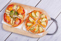 Vegetable pizza small on wooden board Stock Image