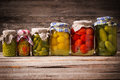 Vegetable preserves on wooden background Royalty Free Stock Photography