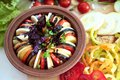 Vegetable ratatouille in earthenware. Cooking home Royalty Free Stock Photo
